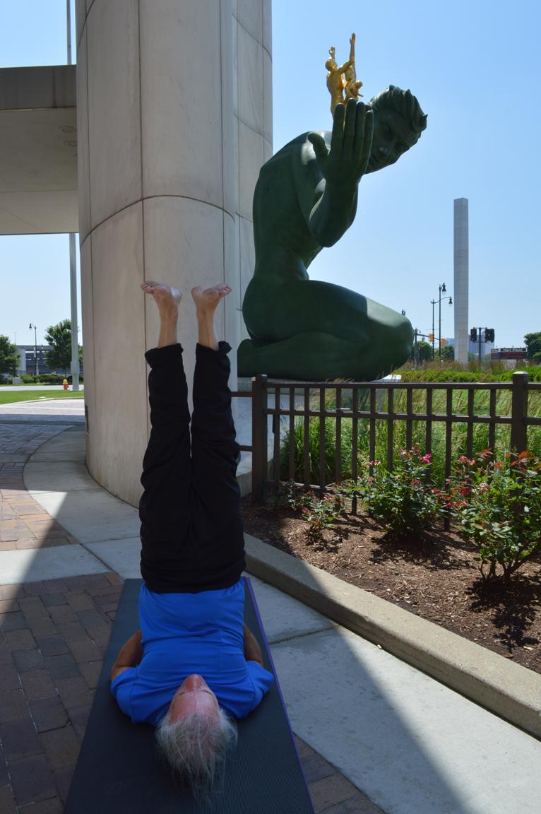 Shoulder Stand in front of Spirit of Detroit statue