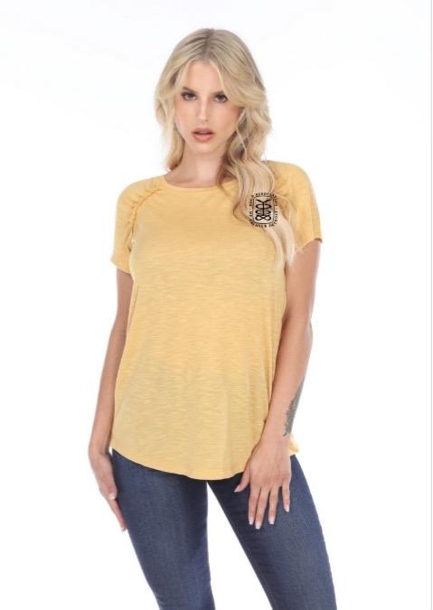 Girl wearing yellow YAGD t-shirt