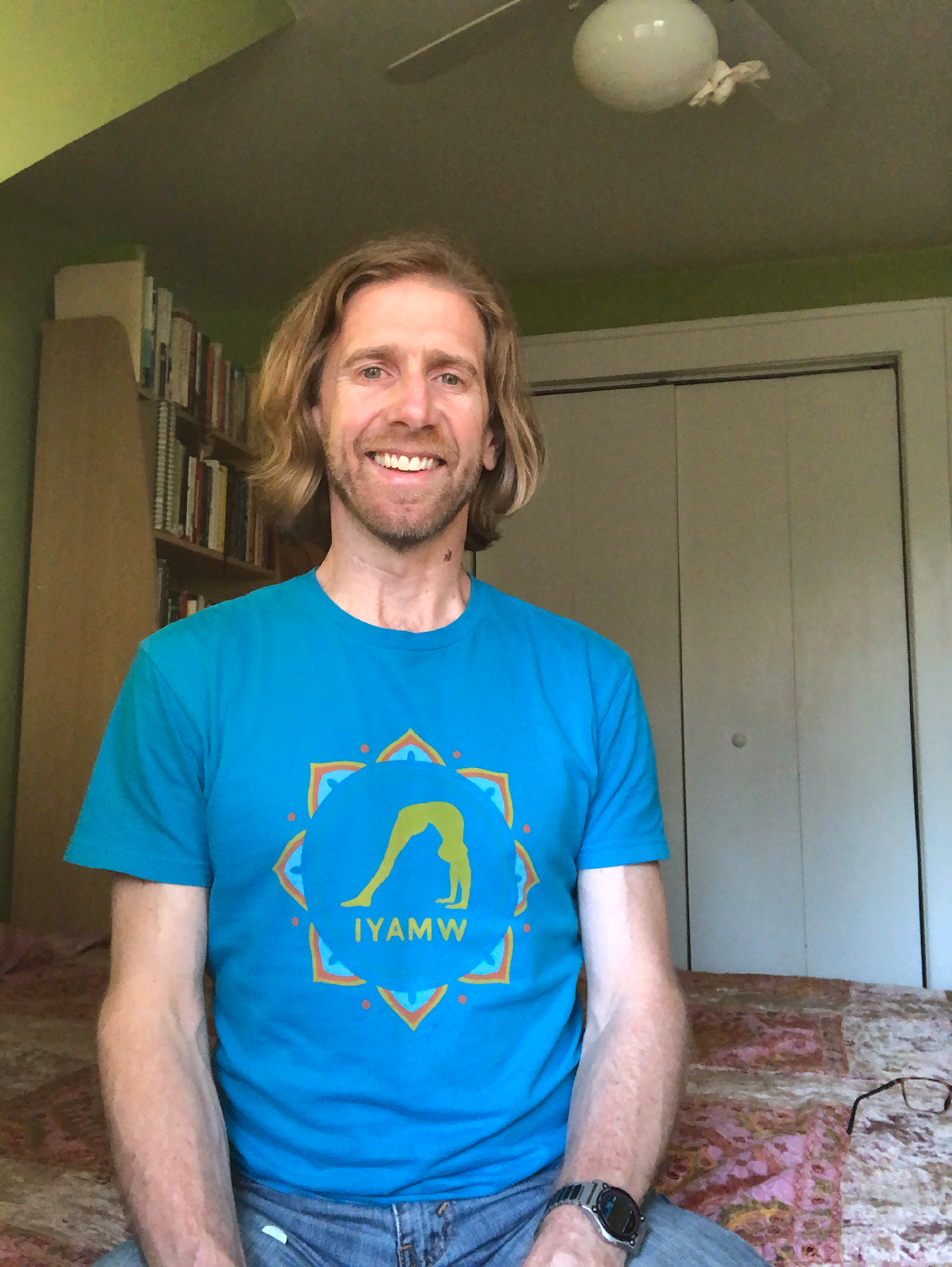 Chris Briney smiling with a blue shirt
